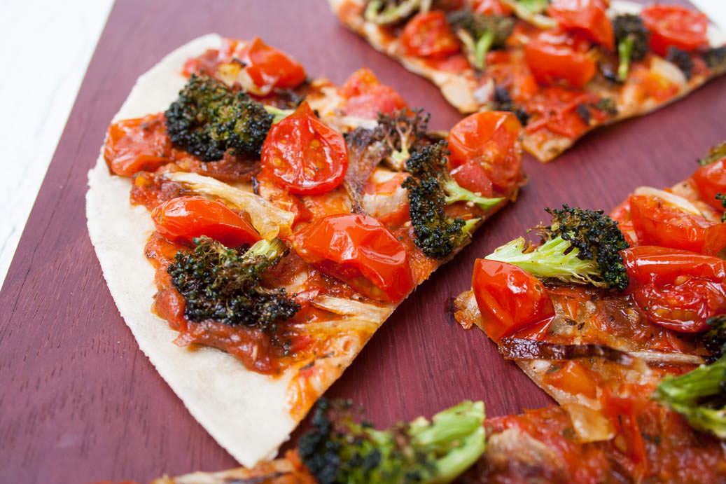 Roasted Broccoli and Tomato Tortilla Pizza close up.