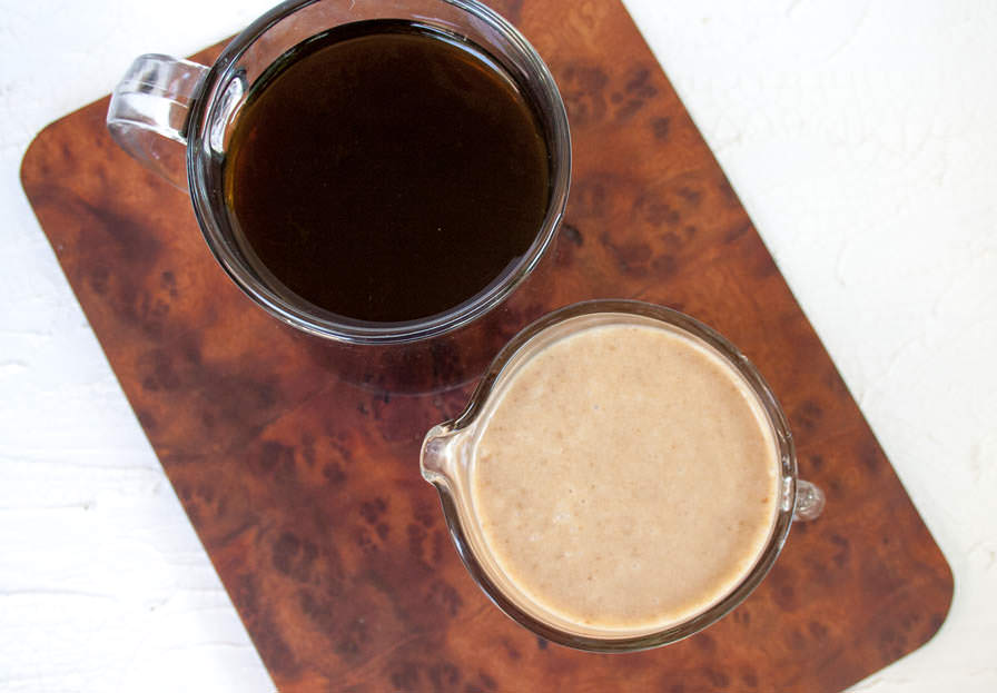 Homemade Caramel Coffee Creamer birds eye view with a cup of black coffee.