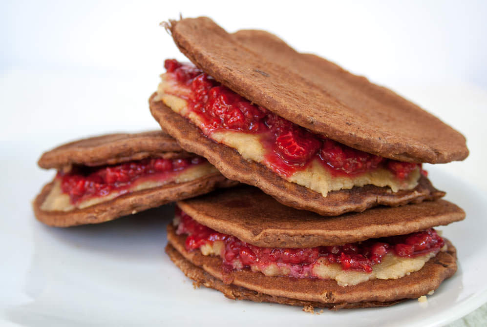 Raspberry and Almond Butter Chocolate Almond Pancake Sandwiches close up.