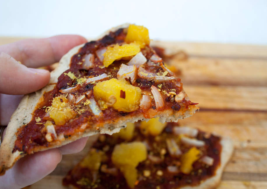 Chipotle Pizza with Pineapple and Onion in hand