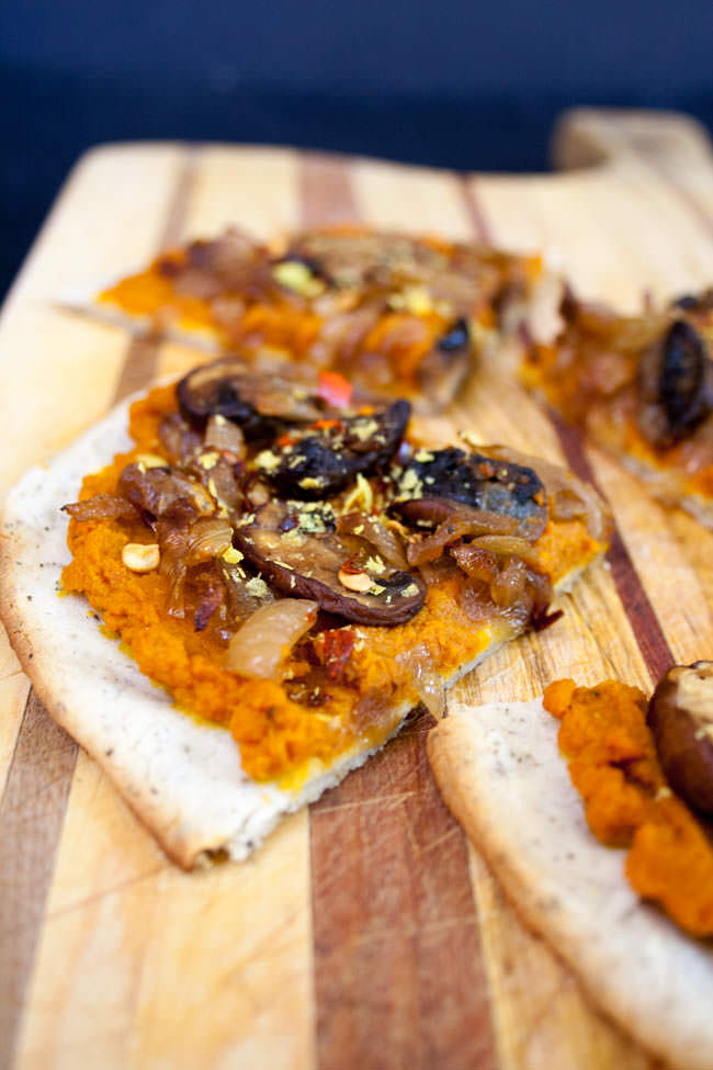 Chipotle Pumpkin Pizza with Caramelized Onions and Mushrooms vertical close up.