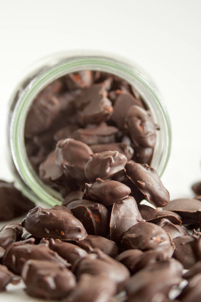 Chocolate Covered Almonds spilling out of jar.
