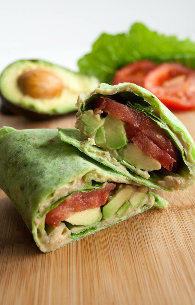 ALT (Avocado, Lettuce, and Tomato) Wrap on cuttnig board.