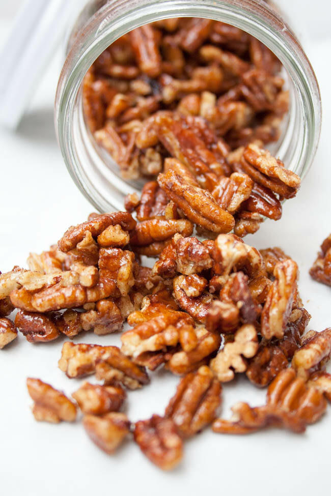 Candied Pumpkin Pie Spice Pecans spilling out of jar.