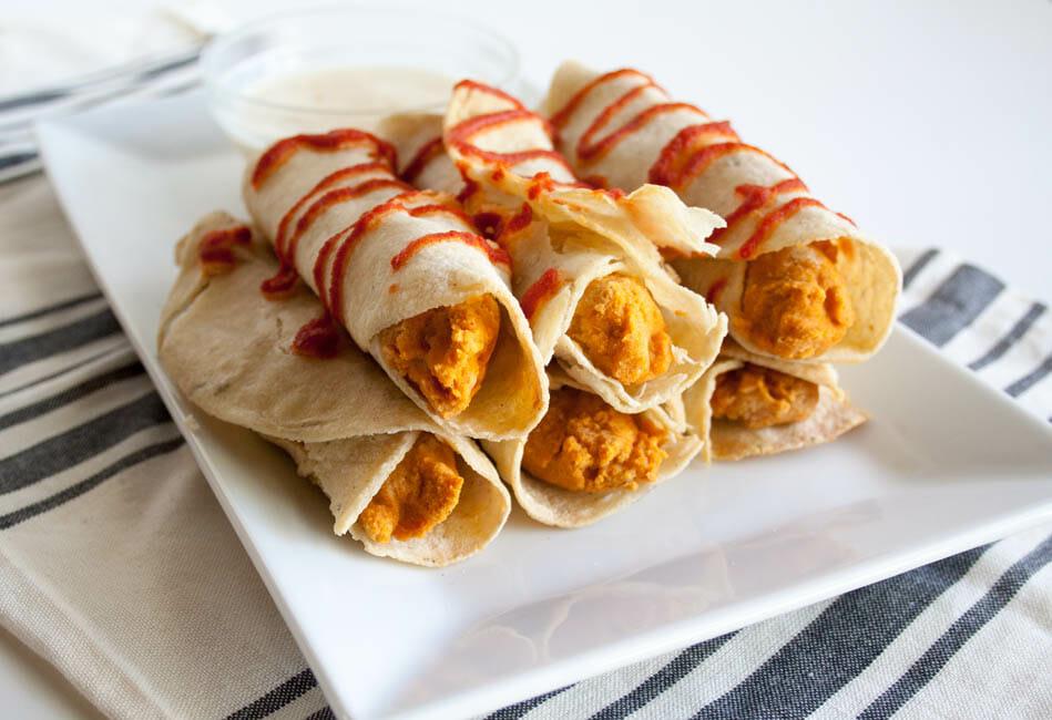Sriracha Hummus Taquitos with Pineapple Mango Dipping Sauce on plate.