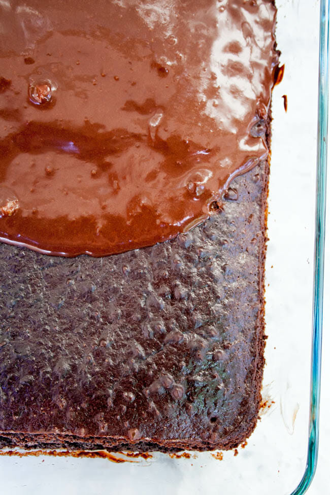 2 Ingredient Chocolate Cake in baking dish, half frosted.
