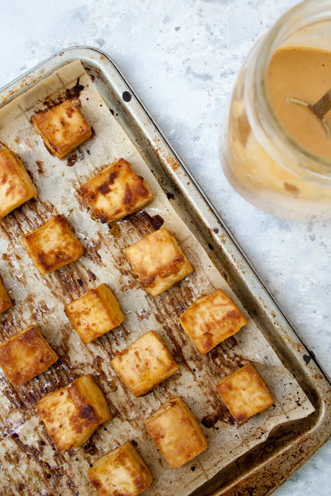 Crispy Peanut Tofu on sheet pan birds eye view.