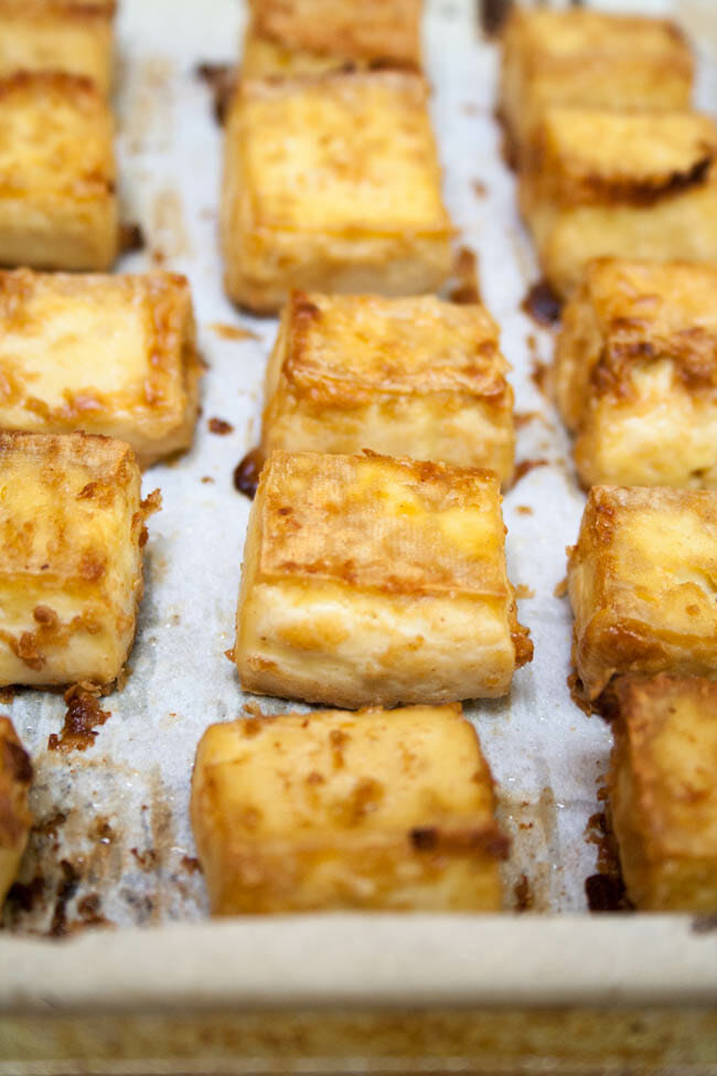 Crispy Baked Tofu with Peanut Sauce close up on baking sheet