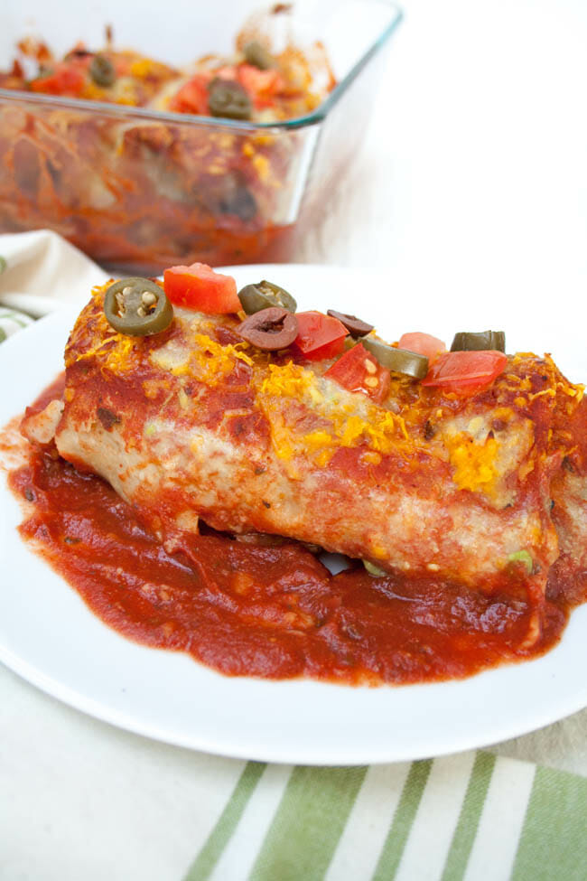 Smothered Vegan Burrito with baking dish in the background.