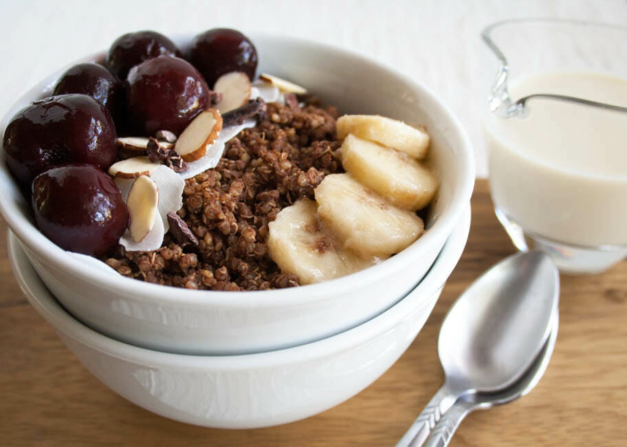 Chocolate Quinoa Breakfast Bowl close up with almond milk.