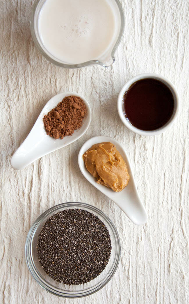 Chocolate Peanut Butter Chia Pudding ingredients in bowls and ramekins.