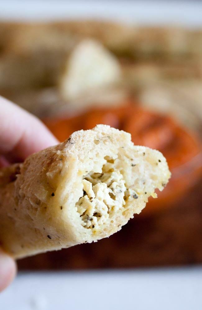 Tofu Ricotta Stuffed Breadstick cut in half to show filling.