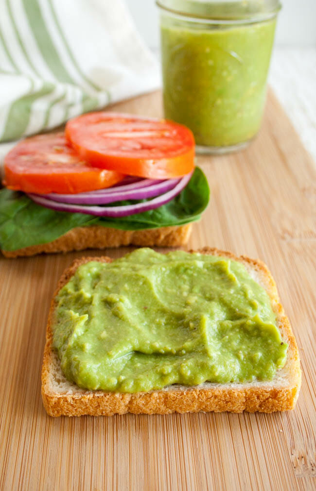 Vegan Mayonnaise made from avocado on an open faced sandwich close up.