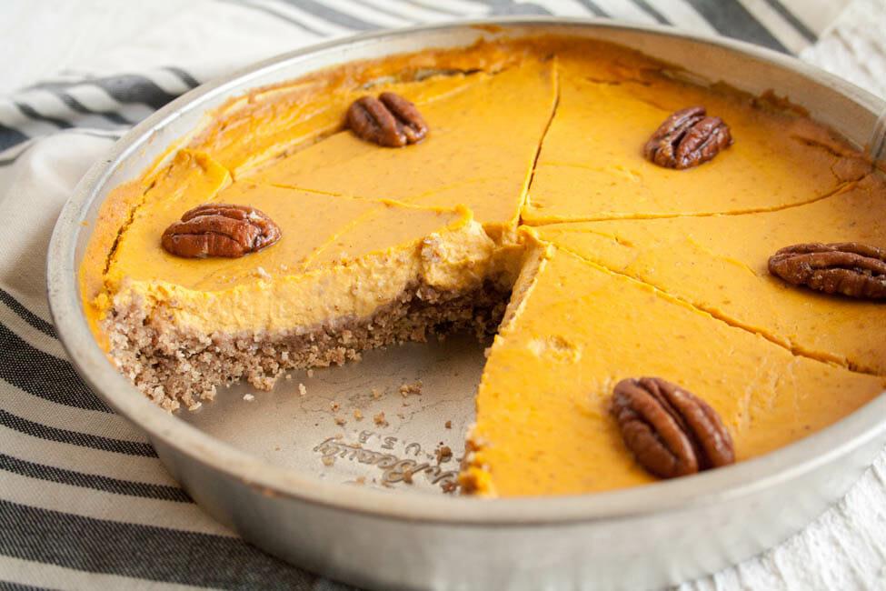 Creamy Vegan Pumpkin Cheesecake in baking pan.