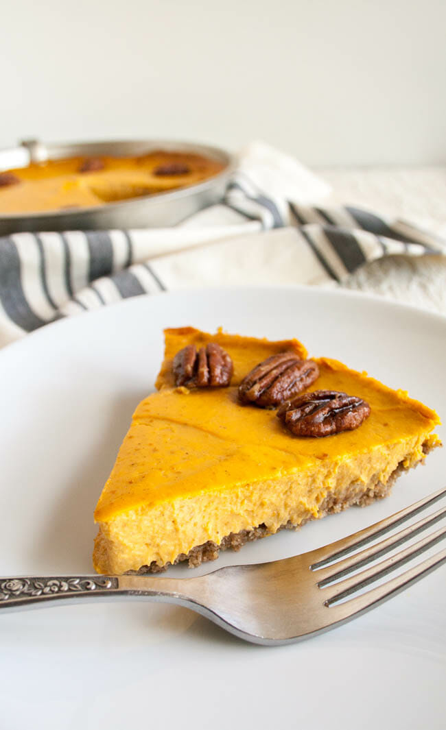 Creamy Vegan Pumpkin Cheesecake slice close up with fork.