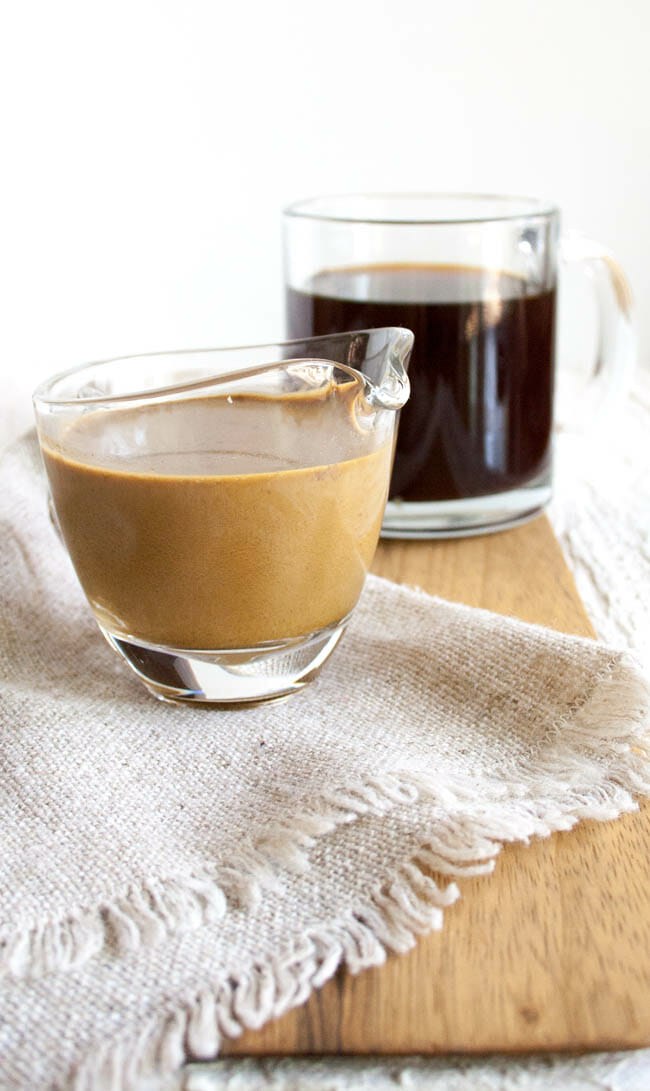 Gingerbread Coffee Creamer with coffee in background.