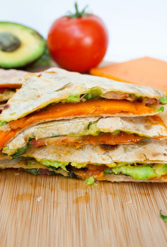 Vegan ALT (Avocado, Lettuce, and Tomato) Quesadilla on cutting board.