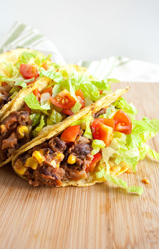 Black Bean and Corn Tacos on a cutting board.