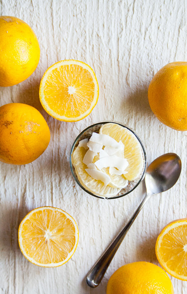 Orange Creamsicle Chia Pudding birds eye view with oranges and a spoon.