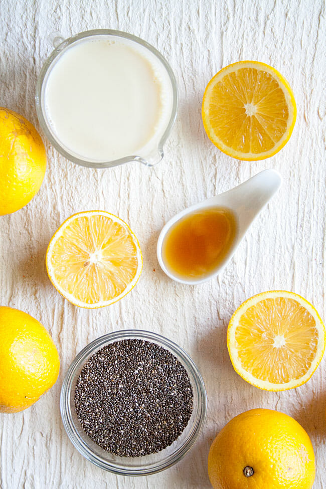 Vegan Chia Pudding ingredients: oranges, almond milk, chia seeds, and maple syrup.