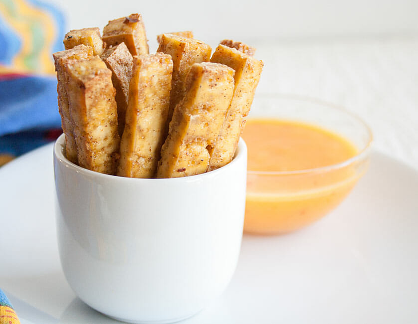Spicy Baked Tofu Fries with Sweet Chili Mango Dipping Sauce in the background.