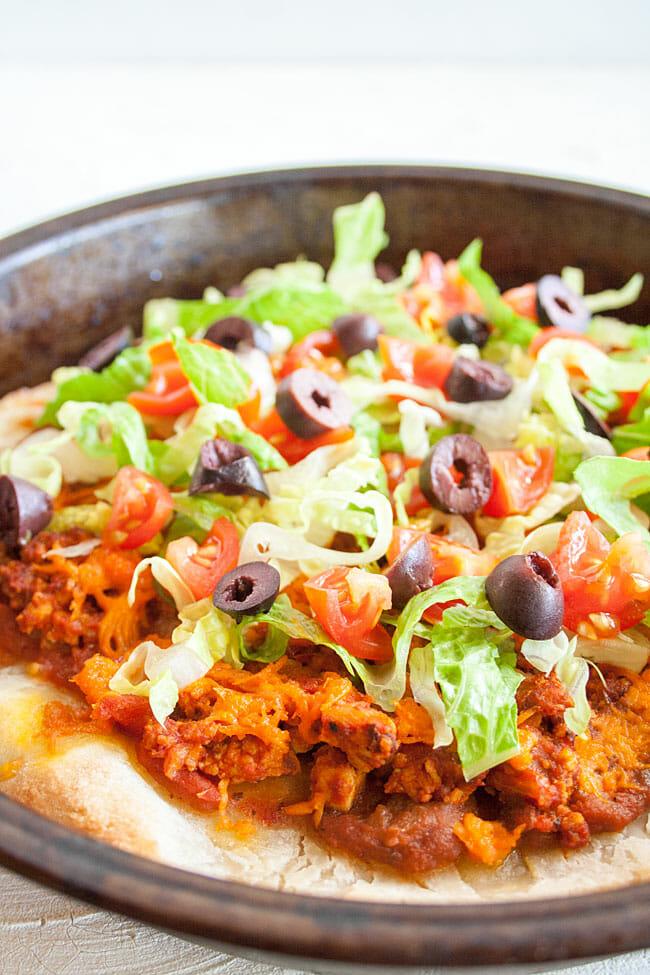Vegan Taco Pizza in pan close up.