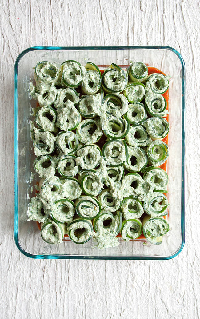 Zucchini Lasagna Rolls in a baking dish before marinara is poured on top.