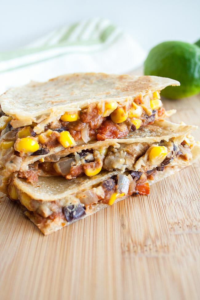 Black Bean and Corn Hummus Quesadilla on cutting board.