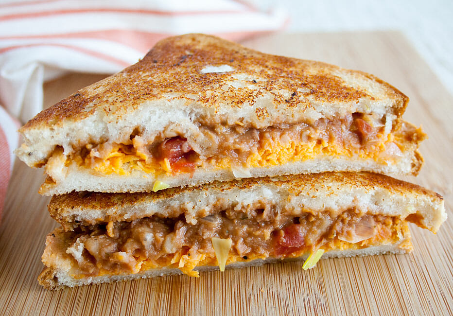 Refried Bean Grilled Cheese sliced in half and stacked.
