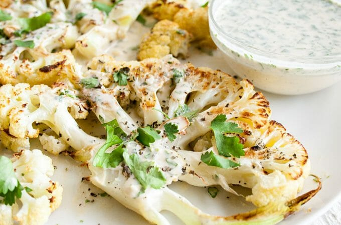 Roasted Cauliflower Steaks with Cilantro Tahini Dressing