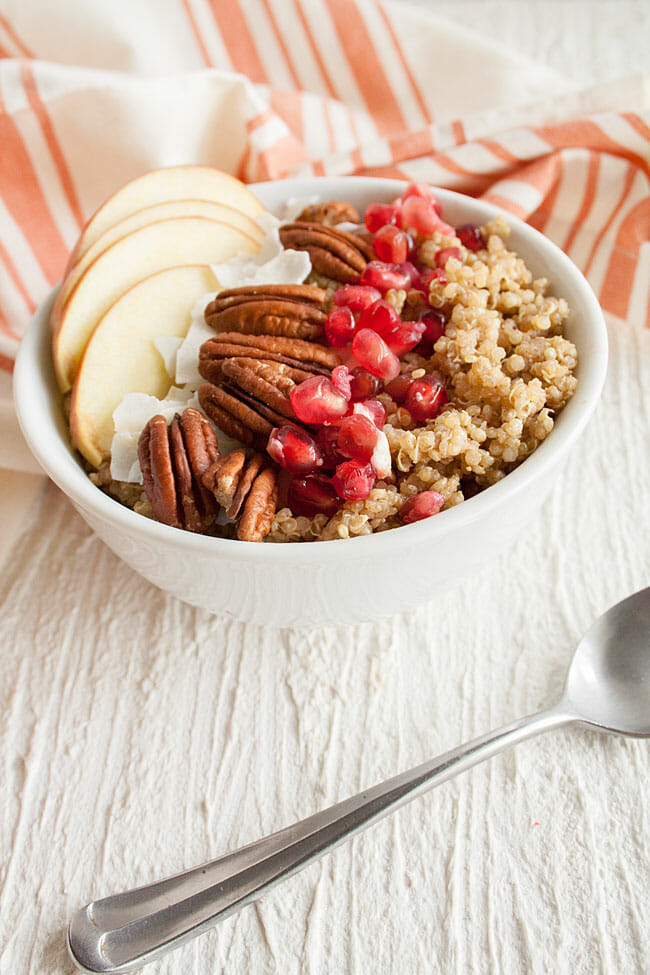 Spiced Quinoa Breakfast Bowl in bowl with spoon.