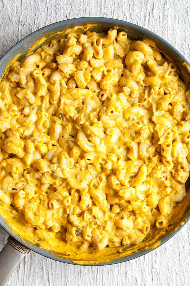 Vegan Mac and Cheese with Nacho Cheese Sauce in pan close up.
