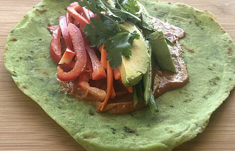 Thai Wrap open faced on cutting board.