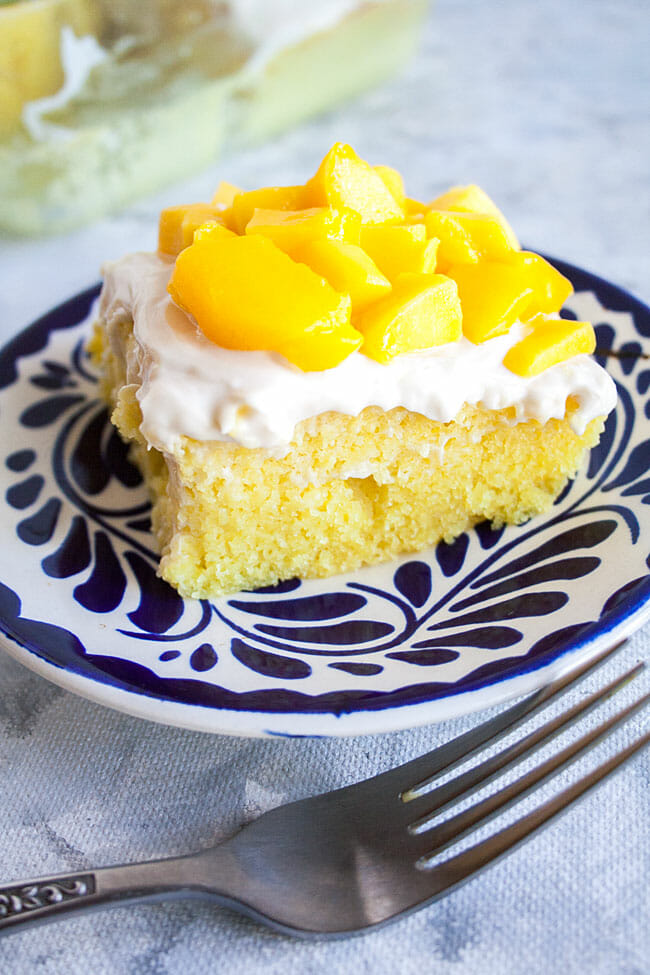 2 Ingredient Mango Cake on a plate with fork.
