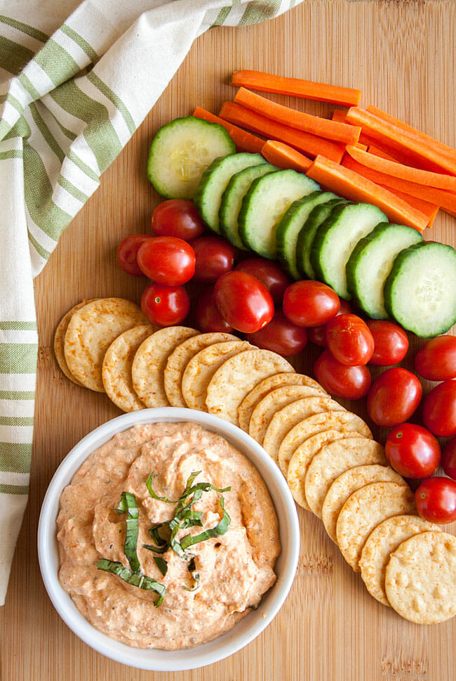 Roasted Red Pepper Dip with vegetables on cutting board.