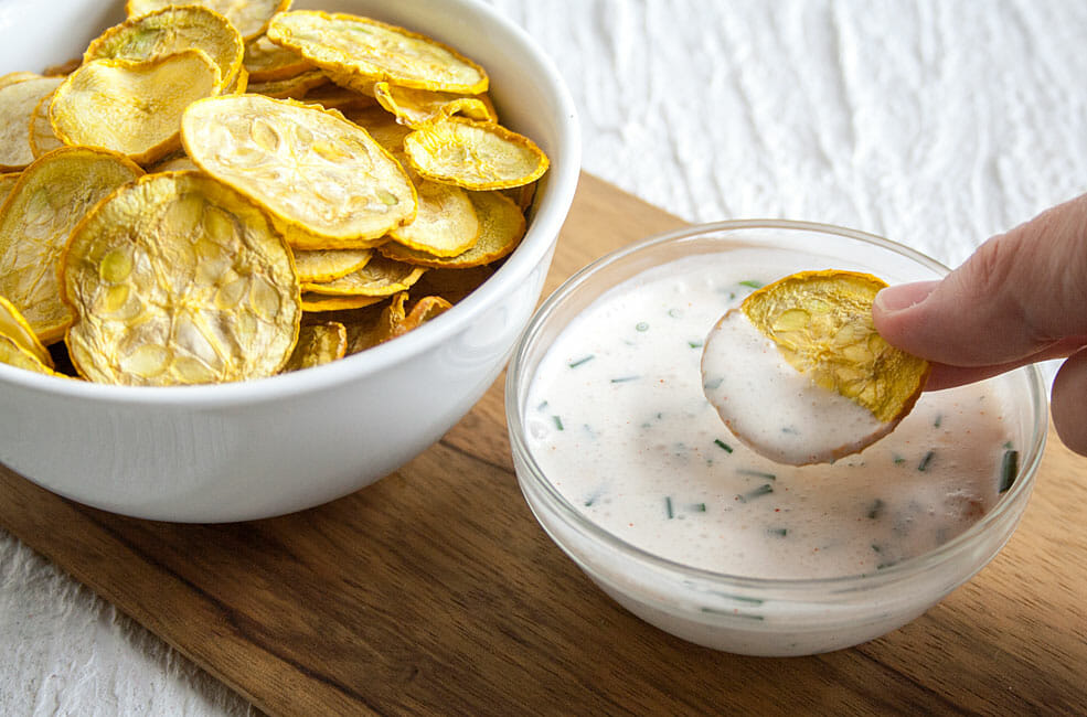 Dehydrated Squash Chips with vegan ranch dressing.