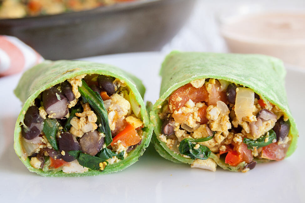 Black Bean Breakfast Burrito sliced in half.