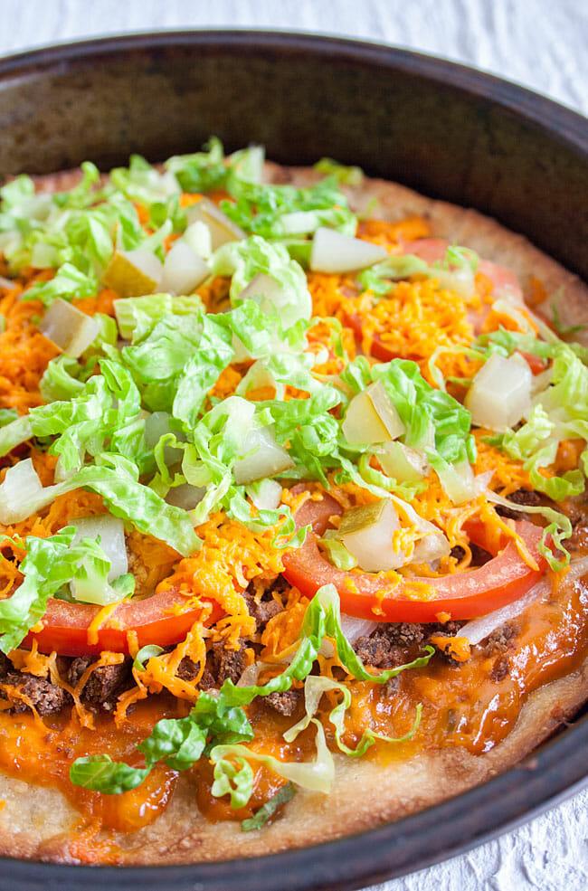 Vegan Cheeseburger Pizza in a pan.