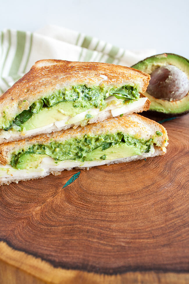 Avocado Pesto Grilled Cheese on cutting board.