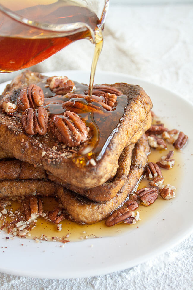French Toast with maple syrup being poured on top.