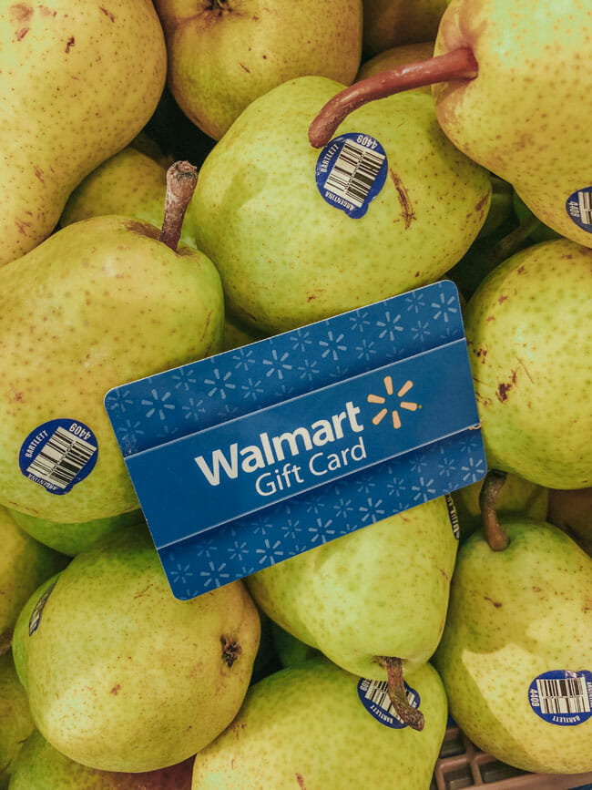 Walmart gift card sitting on top of a bunch of pears.