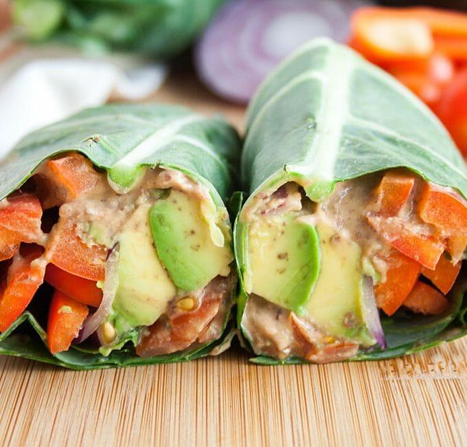 Black Bean Hummus Collard Wrap (vegan, gluten free) - This spicy vegan wrap is packed with flavor. You won't miss the bread with this easy meal! #collardwrap #veggiewrap #veganwrap