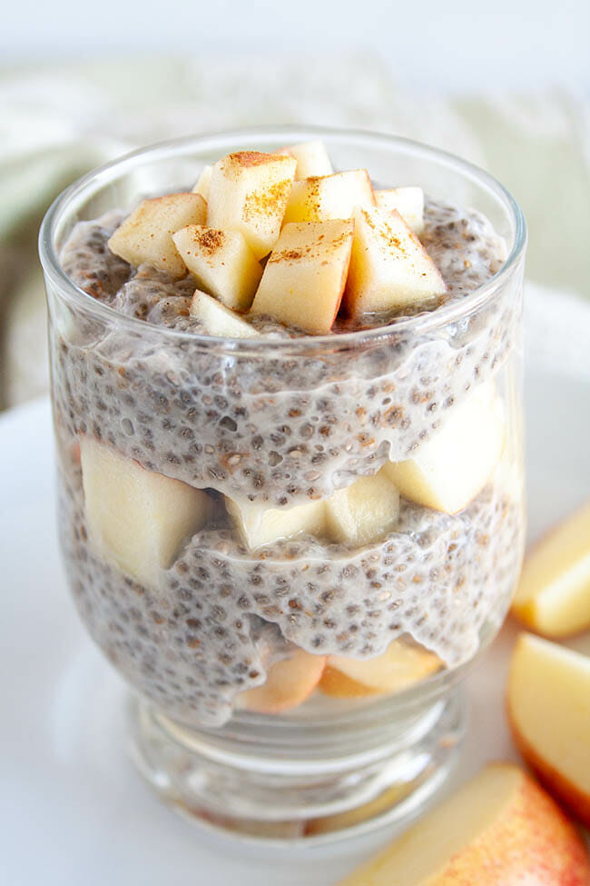 Apple Cinnamon Chia Pudding in a jar with layers of chopped apples.