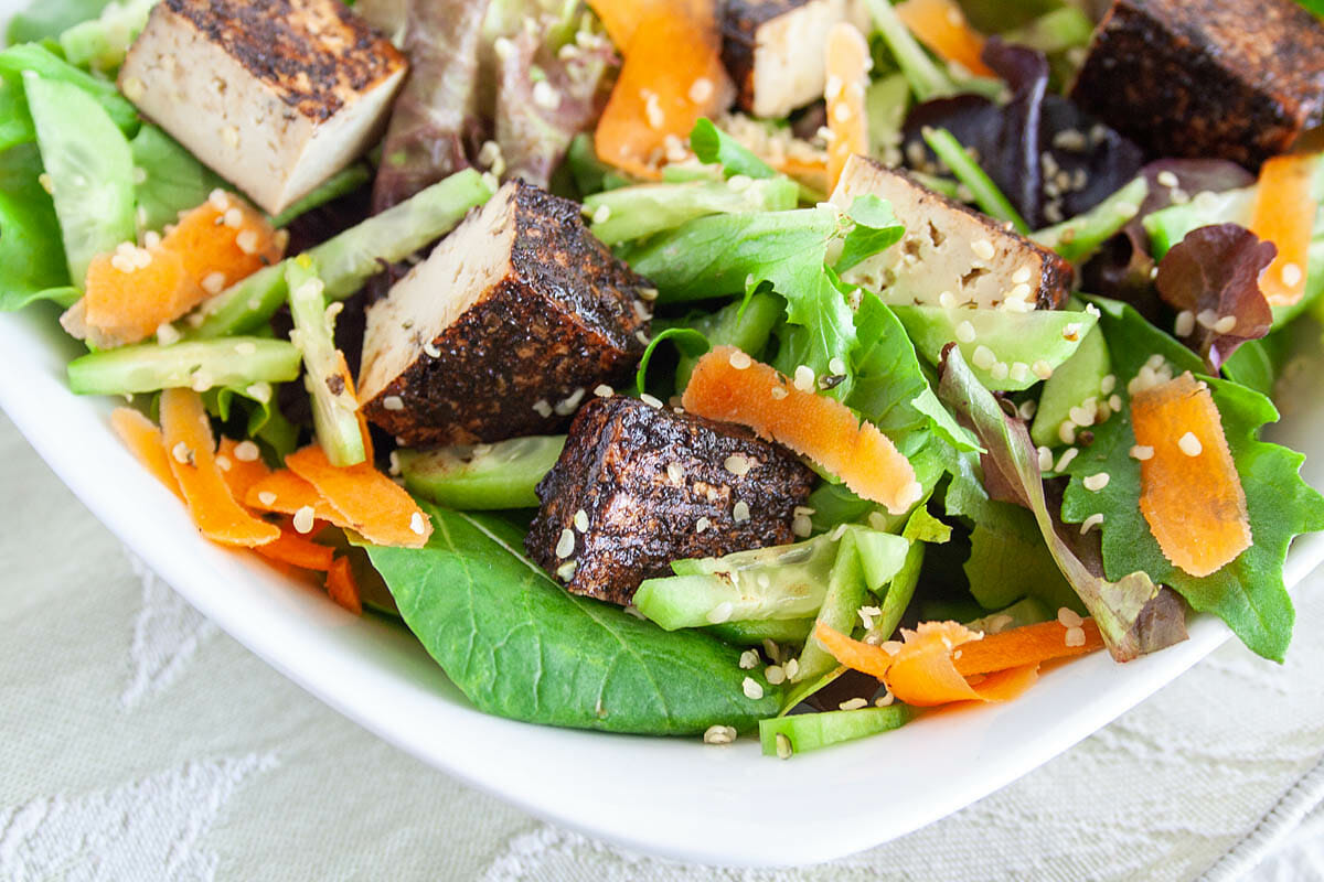 Balsamic Tofu on a salad close up.