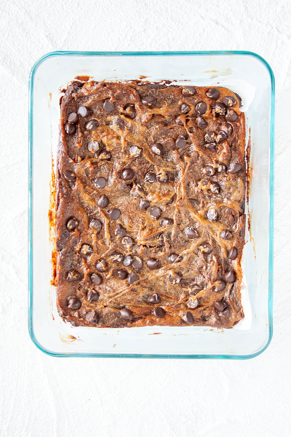 Vegan Peanut Butter Swirl Brownies in a baking dish bird's eye view.