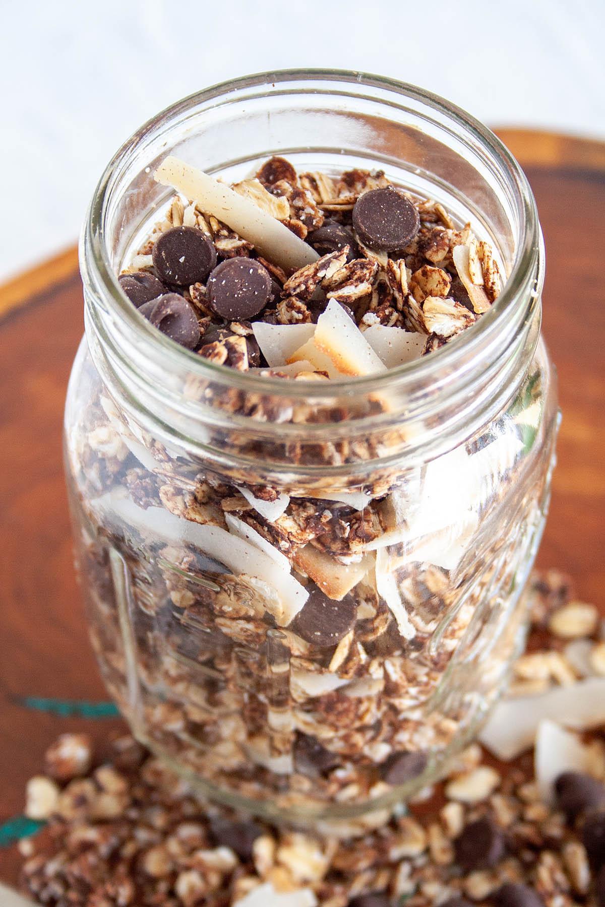 Chocolate Coconut Granola in mason jar close up.