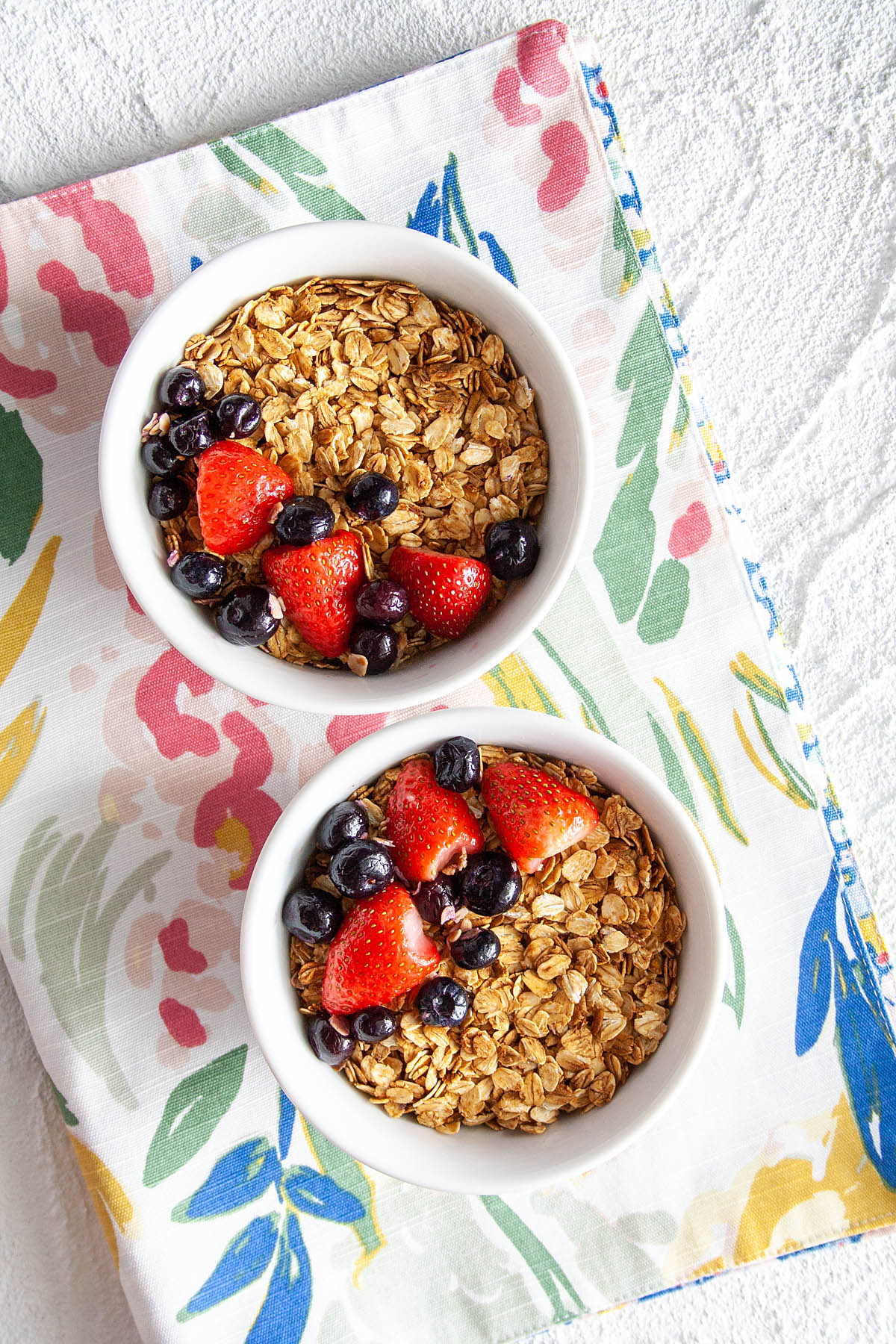Maple and Molasses Granola in two bowls bird's eye view.