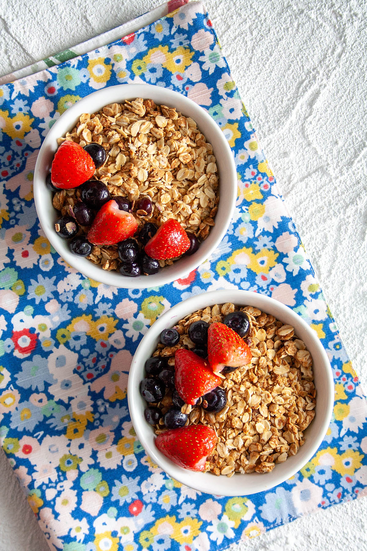 Peanut Butter Granola in two bowls bird's eye view.