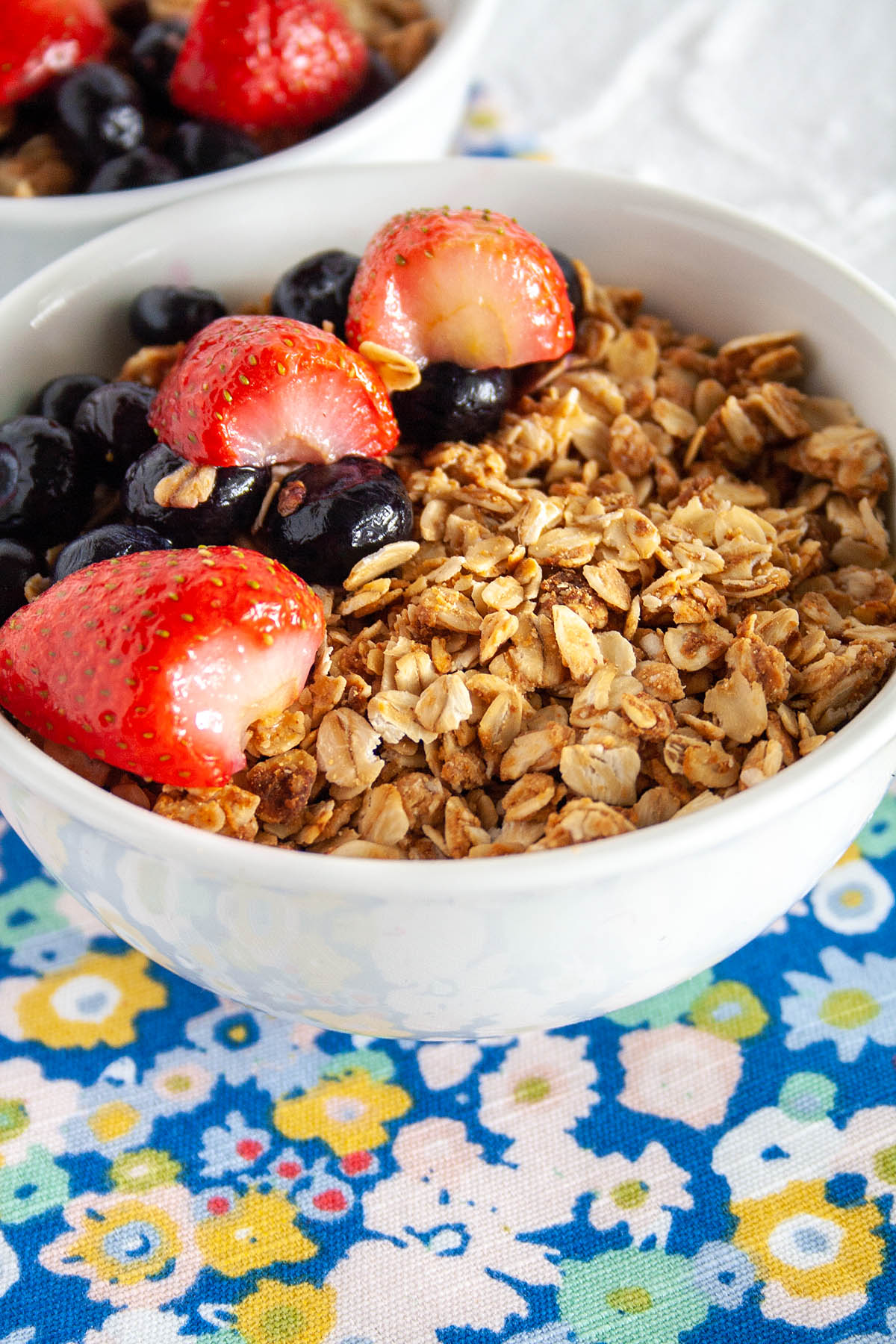 Peanut Butter Granola in a bowl with berries.