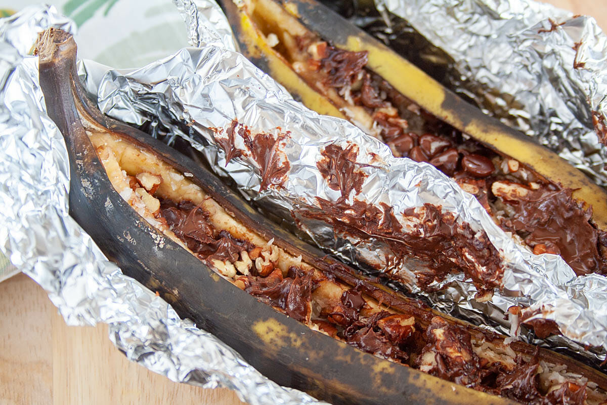 Campfire Stuffed Bananas in tinfoil close up.